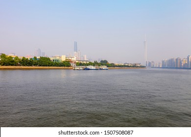 Guangzhou, China - Feb 2012: Guangzhou Pearl River Embankment Panorama. Chinese name Zhujiang river. High rising skyscrapers, banks, modern buildings along the Pearl River. Eternal smog over the city