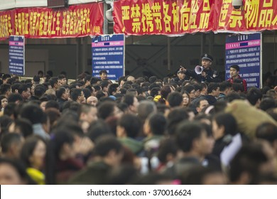 GUANGZHOU, CHINA - JAN. 31. 2016:People going toward trains on main railway station in Guangzhou, travel for the annual Chinese Lunar New Year and Spring Festival holidays