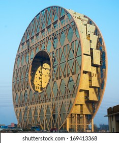 """GUANGZHOU, CHINA - JAN.1: Guangzhou Circle on Jan.1, 2014 in Guangzhou, China.The appearance of large ring architecture and design inspiration comes from the Nanyue King """"jade""""."""