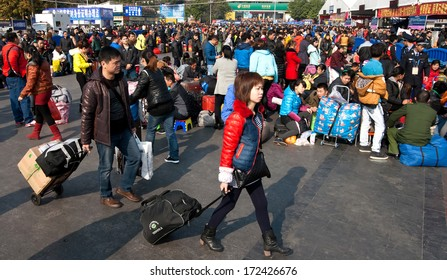 GUANGZHOU, CHINA - JANUARY 20:  Thousands Chinese people leaving city return home for Chinese New Year on January 20, 2014,Guangzhou Railway serves 200000 passengers per day.