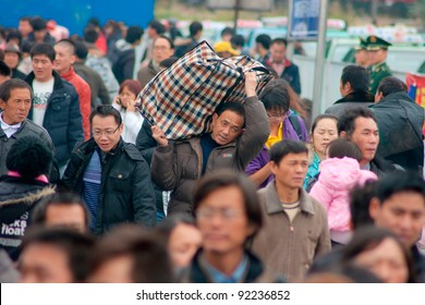 GUANGZHOU, CHINA - JANUARY 8: Thousands of Chinese people leaving the city to return home for the Chinese New Year on Jan 8, 2012, Guangzhou. Railway serves 250000 passengers per day.