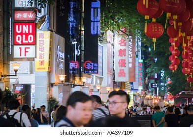 GUANGZHOU, CHINA - MAY 6, 2017: Pedestrians pass through Beijing Road Pedestrian Street. The street is the main shopping district of the city and a major tourist attraction.