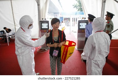 GUANGZHOU, CHINA - OCT. 30. 2014:People have their temperature taken at  Canton Fair. Guangdong province was identified as a front line to prevent the deadly Ebola virus from entering China.