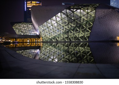 Guangzhou, China - October 12, 2019. Opera house in Guangzhou in the evening and in the water its reflection