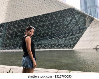 Guangzhou, China – October 23, 2018 : Unidentified woman travel at Guangzhou Opera House in Guangzhou, China on October 23, 2018. Guangzhou Opera House is a landmark building in the city center.