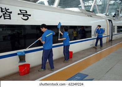 GUANGZHOU, CHINA - SEPT 29:Workers wash cars before travel on September 29, 2010 in newly build Guangzhou South station. China invests in fast and modern railway, trains with speed over 340 km/h.