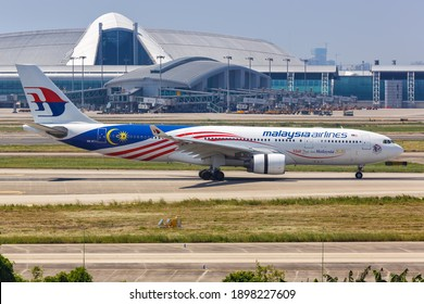 Guangzhou, China - September 24, 2019: Malaysia Airlines Airbus A330-200 airplane at Guangzhou Airport (CAN) in China. Airbus is a European aircraft manufacturer based in Toulouse, France.