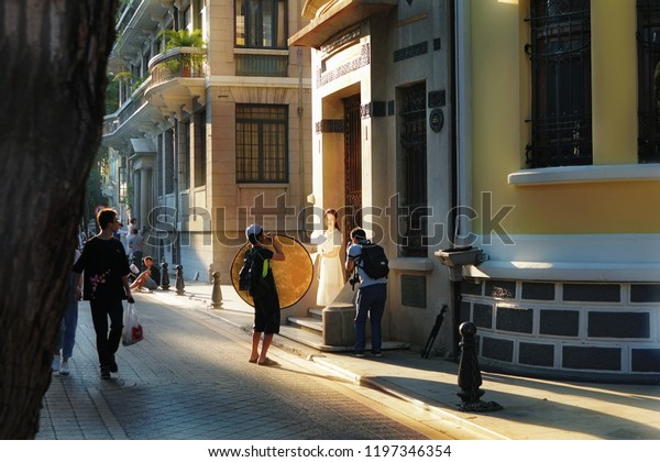 Guangzhou city, China, 6 of October  2018.  Сolonial architecture of Shamien Island, street scene with photographers and a model.