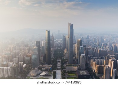 Guangzhou city in fog at sunny morning at summer day, aerial view, China