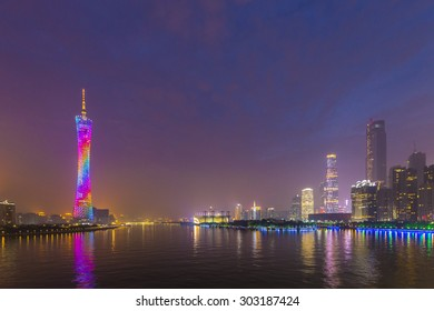 Guangzhou city skyline by night, with Canton Tower on the left bank of the Pearl River