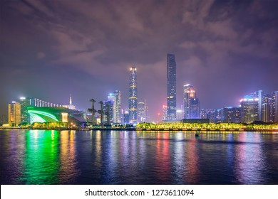 Guangzhou cityscape skyline over the Pearl River illuminated in the evening. Guangzhou, China