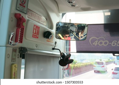 Guangzhou, Guangdong, China - 9/12/2019. A photo of the HIKVISION camera monitoring the bus driver and the first row of passengers. The big brother is watching you.