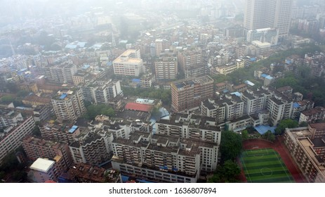 Guangzhou, Guangdong / China - March 7, 2017:  Tianhe Education System Finance Jiesuan Center on Bottom right - looking west from Soluxe Guangzhou Hotel by South Gate of Tianhe Park