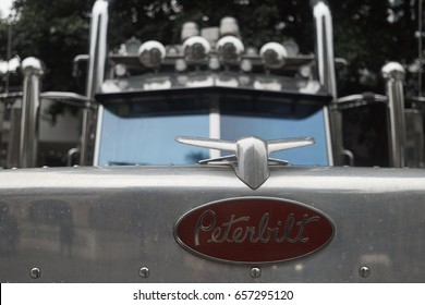 GUANGZHOU SHI, GUANGDONG, CHINA - APRIL 2017: Peterbilt logo on the bonnet of a giant American truck in China.