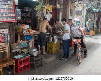Guangzhou/China - August 18 2018: Street food restaurant in the Old Town of Guangzhou. Guangzhou also known as Canton, is the capital and most populous city of the province of Guangdong, China.