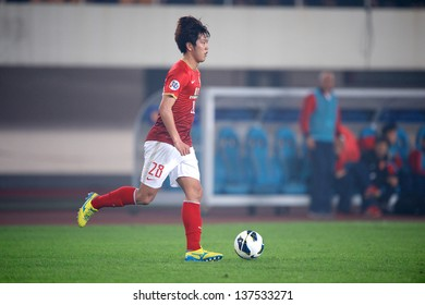 GUANGZHOU,CHINA-APRIL 03:Kim Young-Gwon of Guangzhou Evergrande in action  during the AFC Champions League between Guangzhou Evergrande and Muangthong Utd.at Tianhe Stadium on April 3, 2013in,China.