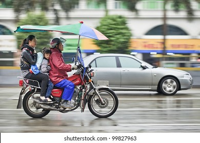 GUANGZHOU-FEB. 25, 2012. Honda motorcycle taxi in the rain on Feb. 25, 2012 in Guangzhou. Honda was founded at 24 September 1948 and has been the world's largest motorcycle manufacturer since 1959.