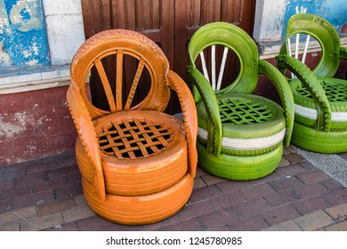 GUANO, RIOBAMBA, ECUADOR - OCT 17,2018 : old tires are recycled and reused to create nice garden chairs, in Guano, near Riobamba on October 17, 2018.