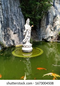 Guanyin marble statue in the middle of the pool