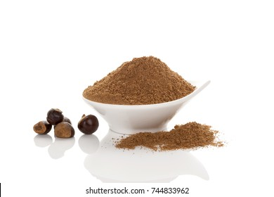 Guarana seeds and powder in bowl. Isolated on white background. Alternative medicine, natural remedy. Nutritional supplement.