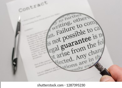 Guarantee conditions of a contract are checked carefully with a magnifying glass