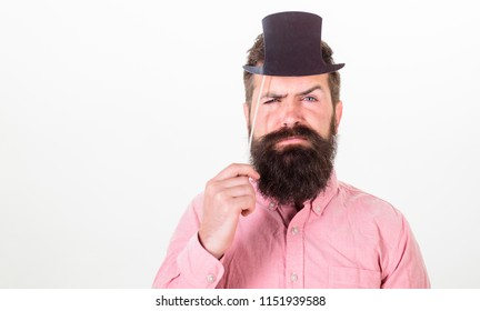 Guaranteed ways appear smarter than you are. Great to be smart but intelligence is hard thing to pin down. Man bearded hipster hold cardboard top hat to look smarter and serious on white background.
