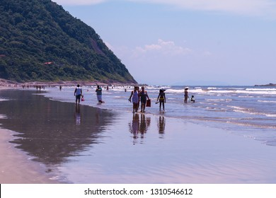 Guarau, Peruibe, SP / Brazil - 02/10/2019: Tourists on Guarau Beach, Peruibe located in the region near the Jureia Ecological Station