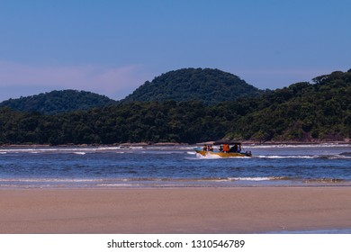 Guarau, Peruibe, SP / Brazil - 02/10/2019: Tourists playing on Guarau Beach and river in Peruibe located in the region near the Jureia Ecological Station