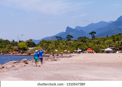 Guarau, Peruibe, SP / Brazil - 02/10/2019: Tourists on Guarau Beach ad river in Peruibe located in the region near the Jureia Ecological Station