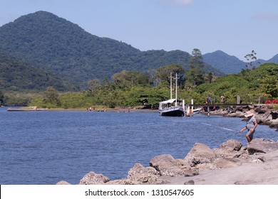 Guarau, Peruibe, SP / Brazil - 02/10/2019: Tourists on Guarau Beach and river in Peruibe located in the region near the Jureia Ecological Station