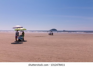Guarau, Peruibe, SP / Brazil - 02/10/2019: People in the tranquil Guarau sand beach in Peruibe