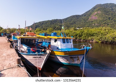 Guarau, Peruibe, SP / Brazil - 02/10/2019: Fishing boats in the Peruibe river.