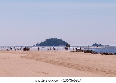 Guarau, Peruibe, SP / Brazil - 02/10/2019: People on the beach with the island in the background.