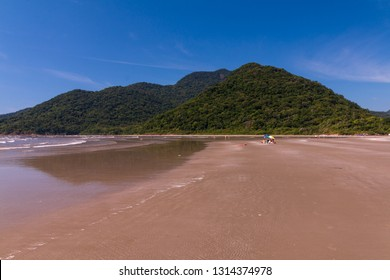 Guarau, Peruibe, SP / Brazil - 02/10/2019: Tourists in a sunny Sunday morning in Guarau beach.
