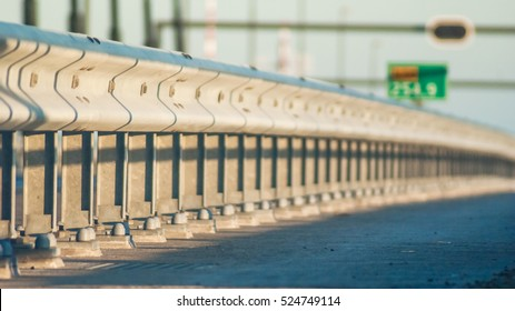 Guard rail or guardrail, sometimes referred to as guide rail or railing, is a system designed to keep people or vehicles from straying into dangerous or off-limits areas.