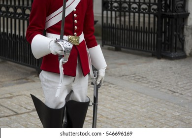 Guard of the royal british army stands with sword in hand. selective focus, shallow depth of field