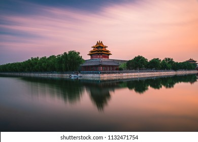 A guard tower is reflected in the moat that surrounds the Forbidden City in Beijing, China.