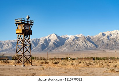 Guard Tower with spotlight outside the Manzanar Japanese-American Internment camp with Sierra Nevada mountains in the background