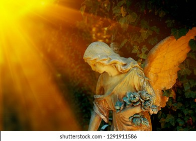Guardian angel statue in sunlight as a symbol of strength, truth and faith. Religion tradition.