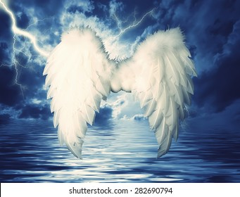 Guardian Angel white wings over dramatic sky. Religion and spiritual concept