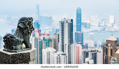Guardian lion with Hong Kong cityscape background.