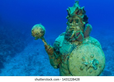 The Guardian of the Reef statue in Grand Cayman. This underwater statue presides over the reef and in itself makes a habitat for marine creatures