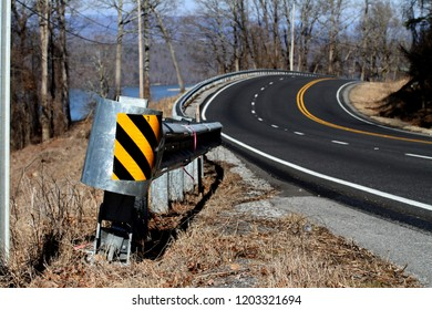 The guardrail on a curvy road heading up a mountain which overlooks the Tennessee River; outside Fort Payne, Alabama.