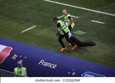 "Guards carry a ""Pussy Riot"" activist out of the pitch at World Cup 2018 final match France vs Croatia. ""Luzhniki"" Stadium, 15th July 2018."