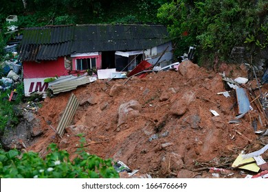 Guaruja, SP / Brazil - March 3, 2020: A house stands damaged after a mudslide caused by heavy rains in the southeastern coast of Brazil, Sao Paulo state.