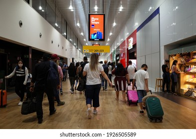 Guarulhos, São Paulo, Brazil - January 11 2021: People wearing mask due to the new coronavirus Covid-19 pandemic at the terminal of São Paulo Guarulhos International Airport.