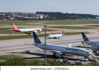 GUARULHOS, SAO PAULO - BRAZIL / SEP 23, 2018: Ground traffic crossing each other in front of the remote parking area of Sao Paulo/Guarulhos Intl. Airport. View from Morrinho spotting location.
