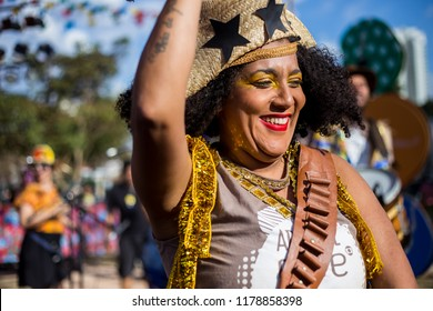 Guarulhos, SP, Brazil - June 24, 2018: A Woman wearing typical clotes of Junina Party(festa junina), dancing, playing music and smiling