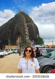 Guatape, Antioquia, Colombia. March 17, 2018. beautiful girl in front of the penol stone also known as piedra del peñol.