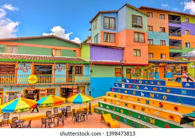 Guatape, Colombia - April 2019 : Colorful houses in cloudy weather, HDR image